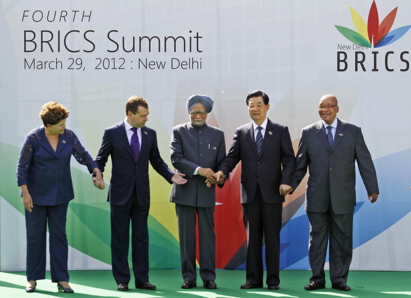 From left to right, Brazil's President Dilma Rousseff, Russian President Dmitry Medvedev, Indian Prime Minister Manmohan Singh,Chinese President Hu Jintao and South African President Jacob Zuma join hands during the group picture for the BRICS 2012 Summit in New Delhi, India, Thursday, March 29, 2012. Heads of States of the five nations are meeting in the Indian capital Thursday. (AP Photo/Saurabh Das)
