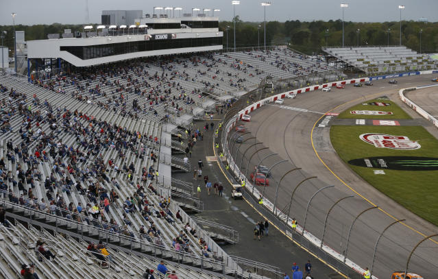 Fans watch the start of the NASCAR Xfinity Series auto race at Richmond International Raceway in Richmond, Va., Friday, April 12, 2019. (AP Photo/Steve Helber)