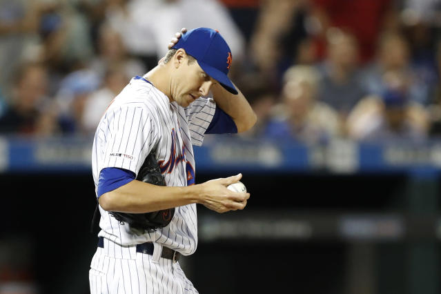 New York Mets starting pitcher Jacob deGrom reacts on the mound after allowing a three-run home run to Chicago Cubs' Victor Caratini during the seventh inning of a baseball game Thursday, Aug. 29, 2019, in New York. (AP Photo/Kathy Willens)