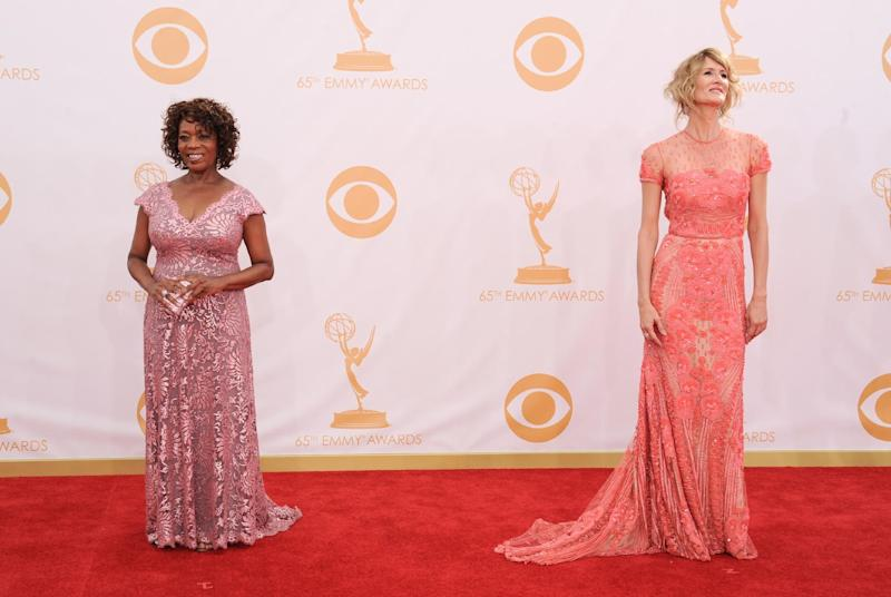 Alfre Woodard, left, and Laura Dern arrive at the 65th Primetime Emmy Awards at Nokia Theatre on Sunday Sept. 22, 2013, in Los Angeles. (Photo by Jordan Strauss/Invision/AP)