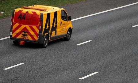 An AA (Automobile Association) recovery vehicle drives along the M6 motorway near Knutsford.