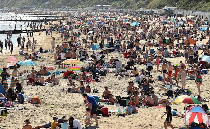 People enjoy the sunshine on the beach near Bournemouth Pier in Bournemouth, southern England. Source: AFP via Getty Images
