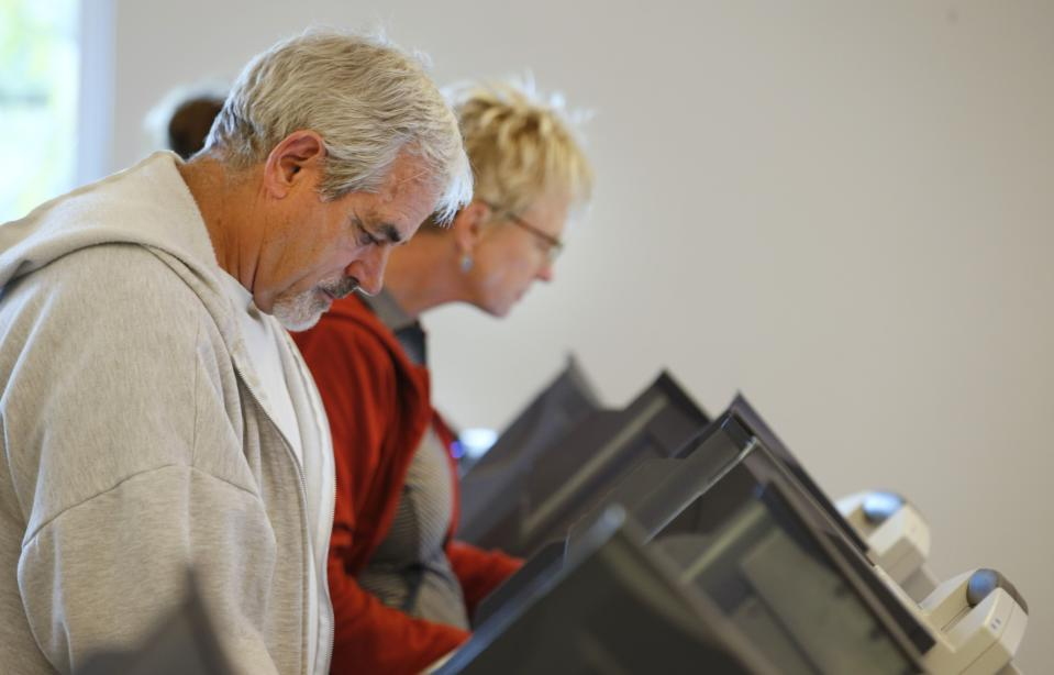 People casting ballots on electronic machines in Utah. Source: George Frey/Getty Images