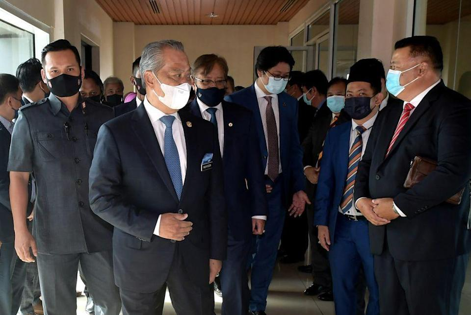 Prime Minister Tan Sri Muhyiddin Yassin arrives at the Kuching International Airport today for a two-day working visit April 1, 2021. — Bernama pic