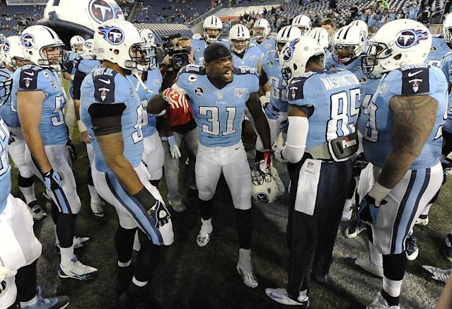 Tennessee Titans safety Bernard Pollard (31) encourages his teammates before an NFL football game against the Indianapolis Colts on Thursday, Nov. 14, 2013, in Nashville, Tenn. (AP Photo/Mark Zaleski)