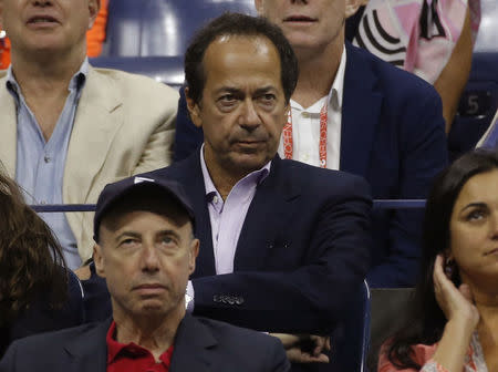 FILE PHOTO -  Hedge Fund manager John Paulson attends the men's singles final match between Roger Federer of Switzerland and Novak Djokovic of Serbia at the U.S. Open Championships tennis tournament in New York, September 13, 2015.      REUTERS/Mike Segar