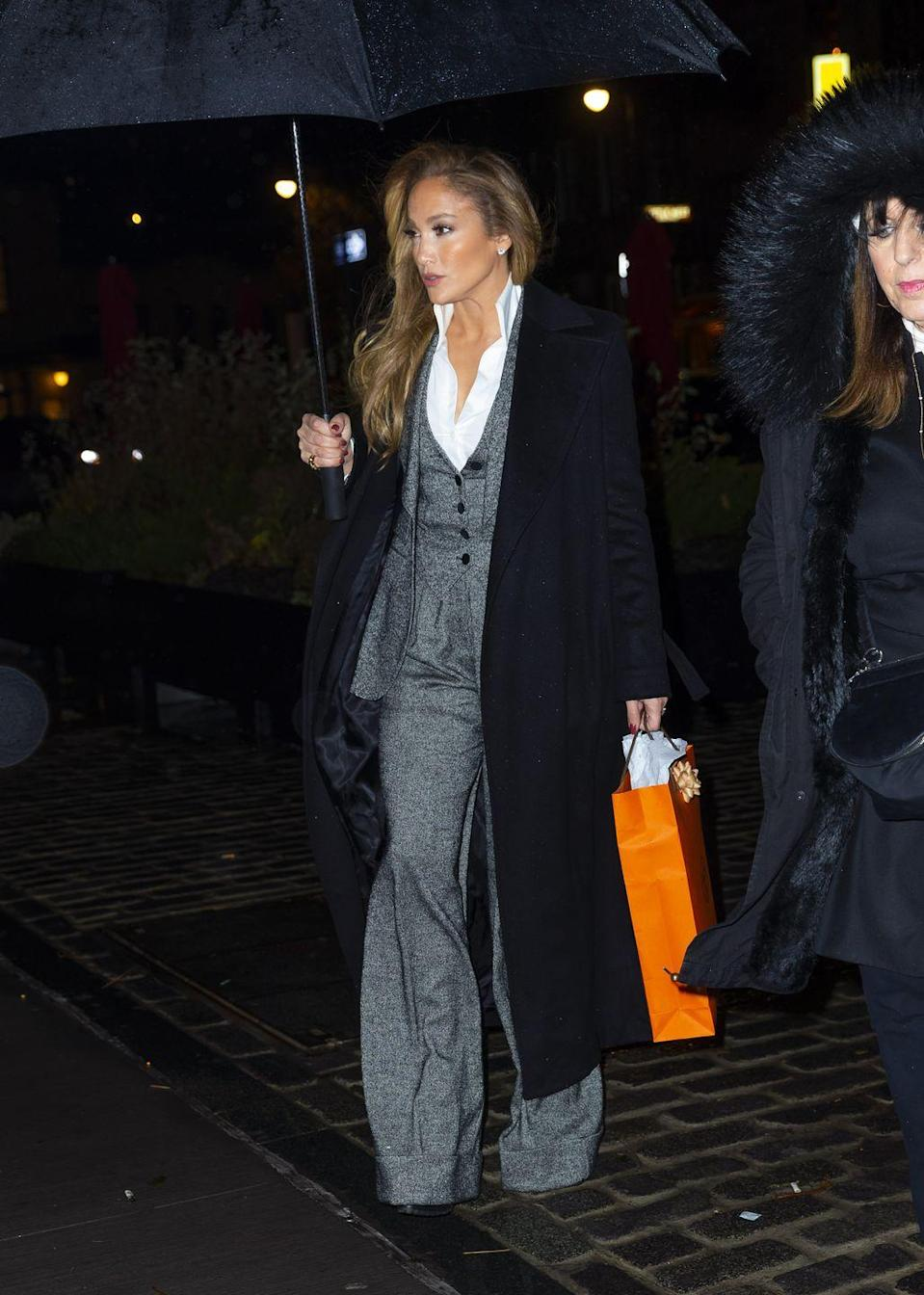 """<p>On Sunday 1 December, Lopez attended a special screening of Hustlers, which was presented by Will Ferrell, wearing a silver Dolce & Gabbana suit styled with a white shirt and black overcoat. The look was reminiscent of <a href=""""https://www.elle.com/uk/fashion/celebrity-style/news/a39336/blake-lively-seven-outfits-fashion-ryan-reynolds/"""" rel=""""nofollow noopener"""" target=""""_blank"""" data-ylk=""""slk:Blake Lively's press wardrobe"""" class=""""link rapid-noclick-resp"""">Blake Lively's press wardrobe</a> when promoting her film A Simple Favour last year.</p>"""