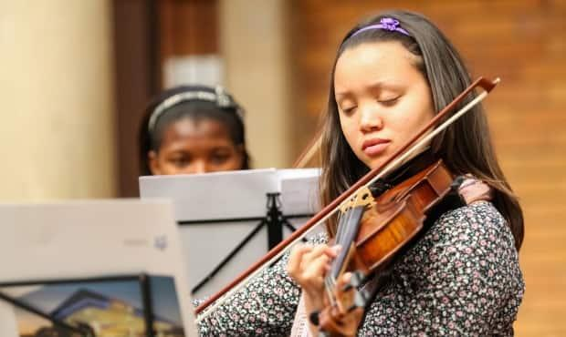 The Greater Victoria school district is dealing with a $7 million deficit. A draft budget for the district includes cuts to elementary- and middle-school music programs. (Shutterstock / Wirestock Creators - image credit)