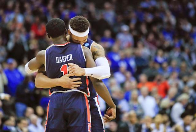 Auburn's Jared Harper (1) and teammate Bryce Brown celebrate near the end of overtime of the Midwest Regional final game against Kentucky in the NCAA men's college basketball tournament Sunday, March 31, 2019, in Kansas City, Mo. Auburn won 77-71 in overtime. (AP Photo/Orlin Wagner)