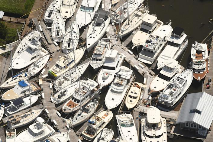 Boats are stacked on top of each other in the Southport Marina Aug. 4, 2020, in Southport N.C., after Hurricane Isaias came ashore overnight in Brunswick County as a category 1 hurricane.