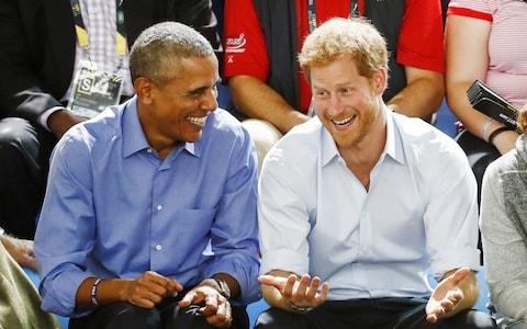 Barack Obama and Prince Harry in Toronto - Credit: Reuters