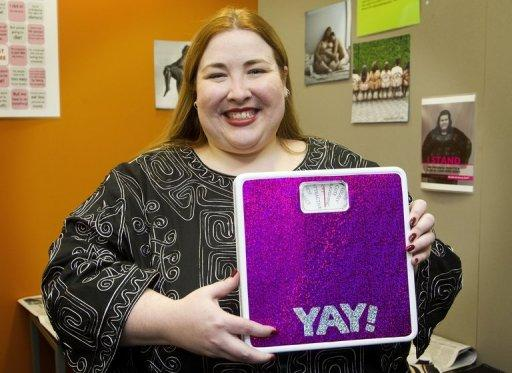 Conference organiser Cat Pause poses with her scale in New Zealand on Thursday