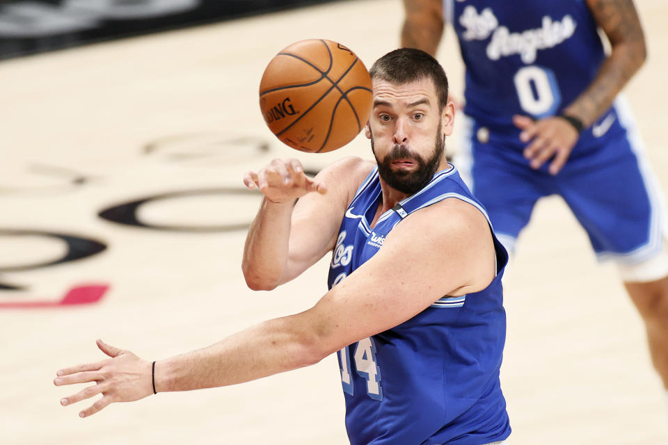PORTLAND, OREGON - MAY 07: Marc Gasol #14 of the Los Angeles Lakers passes the ball against the Portland Trail Blazers during the second quarter at Moda Center on May 07, 2021 in Portland, Oregon. NOTE TO USER: User expressly acknowledges and agrees that, by downloading and or using this photograph, User is consenting to the terms and conditions of the Getty Images License Agreement. (Photo by Steph Chambers/Getty Images)