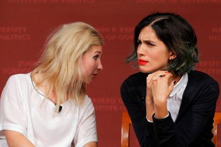 Maria Alyokhina (L) and Nadezhda Tolokonnikova, members of the punk protest band Pussy Riot, listen to a question from the audience during a forum at the Kennedy School of Government at Harvard University in Cambridge, Massachusetts September 15, 2014. REUTERS/Brian Snyder