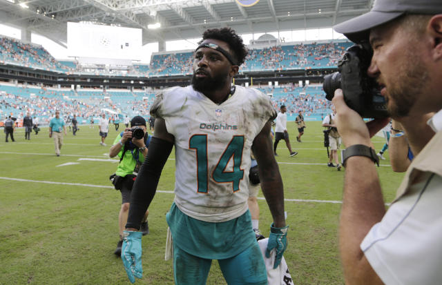 Jarvis Landry's hands were good enough to earn the franchise tag from the Miami Dolphins, a designation that could pay him at least $16.2 million next season. (AP)