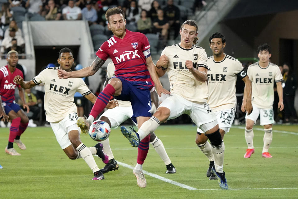 Dallas FC defender Bressan, center left, reaches for ball as Los Angeles FC's Carl Jennings, center right, defends during the first half of an MLS soccer match Wednesday, June 23, 2021, in Los Angeles. (AP Photo/Marcio Jose Sanchez)