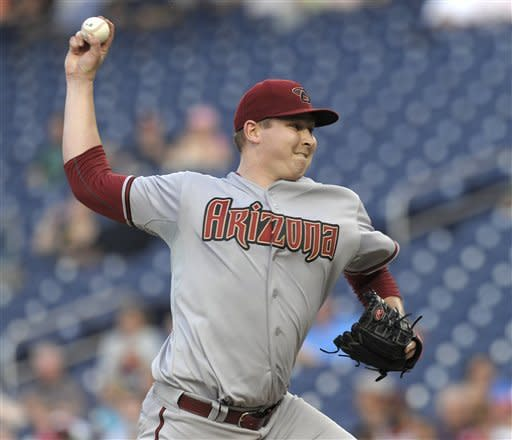 Arizona Diamondbacks starting pitcher Trevor Cahill delivers a pitch against the Washington Nationals during the first inning of a baseball game at Nationals Park in Washington, Tuesday, May 1, 2012. (AP Photo/Susan Walsh)