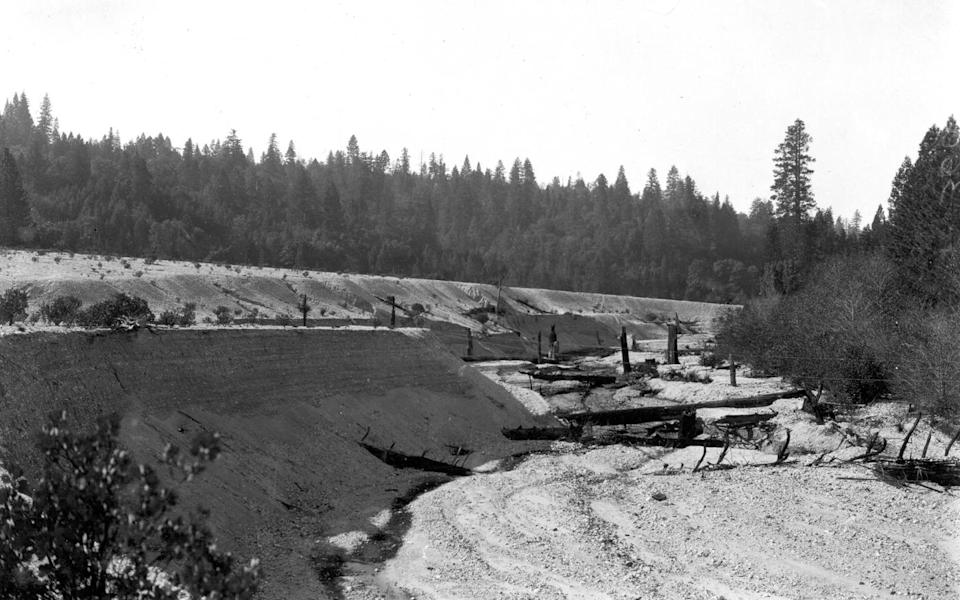In this 1905 photo provided by the U.S. Geological Survey are tailings from hydraulic mines on Spring Creek in Nevada County, Calif. Across the West, early miners digging for gold, silver and copper had no idea that one day something even more valuable would be hidden in the piles of dirt and rocks they tossed aside. Now there's a rush in the U.S. to find key components of cellphones, televisions, weapons systems, wind turbines, MRI machines and the regenerative brakes in hybrid cars, a group of versatile minerals on the periodic table called rare earth elements and old mining tailings piles just might be the answer. (AP Photo/U.S. Geological Survey)