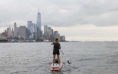Lizzie approaching New York City on her paddleboard - Credit: Maximus in NYC
