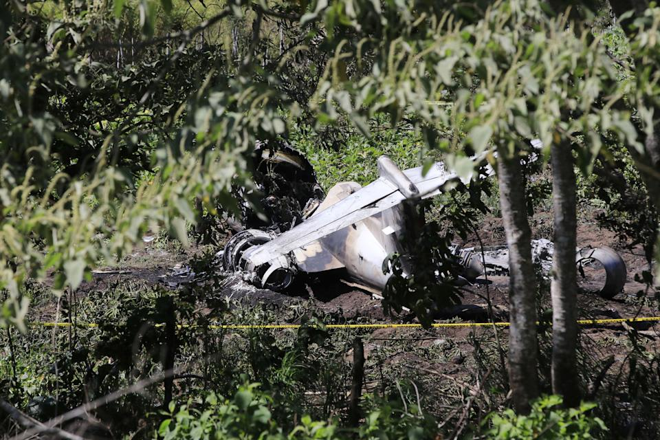 View of a Mexican Air Force plane after it crashed near the airport of Xalapa, Veracruz state, Mexico, on February 21, 2021. - Six Mexican soldiers died Sunday when the aircraft in which they were traveling crashed after taking off from an airport in the eastern state of Veracruz, reported the Secretariat of Defense (Sedena). (Photo by EDUARDO MURILLO / AFP) (Photo by EDUARDO MURILLO/AFP via Getty Images)