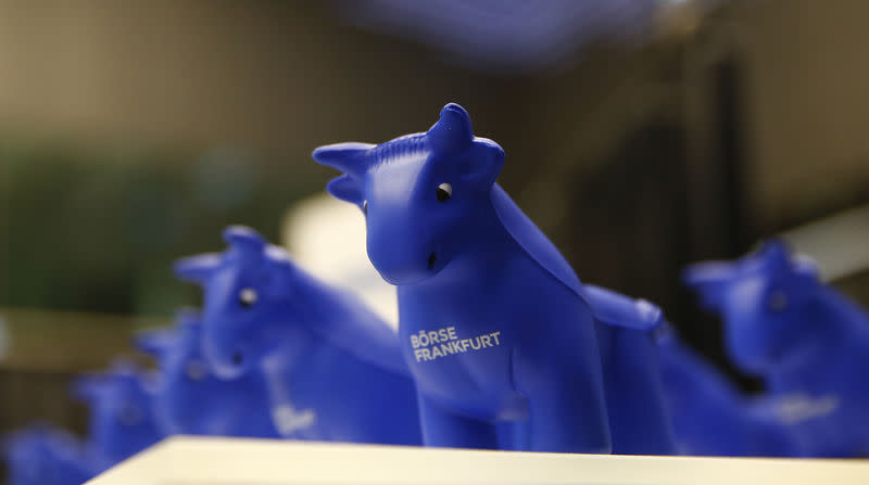 Styrofoam bull figures stand on a counter on the trading floor at the stock exchange in Frankfurt