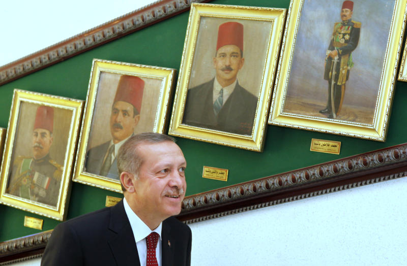 Turkish Prime Minister Recep Tayyip Erdogan looks at paintings showing Egyptain defence ministers of the early part of the last century upon his arrival at the defence ministry in Cairo, Egypt, Tuesday, Sept. 13, 2011 to meet with Field Marshal Mohamed Hussein Tantawi, head of Egypt's ruling military council.  Erdogan, intent on broadening Turkey's influence in the Middle East and the Arab world, started a visit to Egypt and will also visit Tunisia and Libya, two other countries where popular uprisings have ousted autocratic leaders. (AP Photo/Amr Nabil, pool)