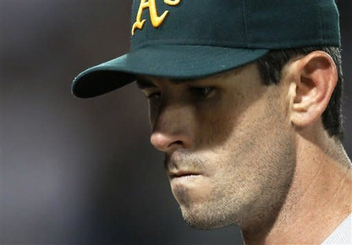 Oakland Athletics starting pitcher Brandon McCarthy heads to the dugout after being taken out of the baseball game by manager Bob Melvin, shortly after giving up a game-tying home run to Chicago White Sox's Dayan Viciedo, during the seventh inning Friday, Aug. 10, 2012, in Chicago. (AP Photo/Charles Rex Arbogast)