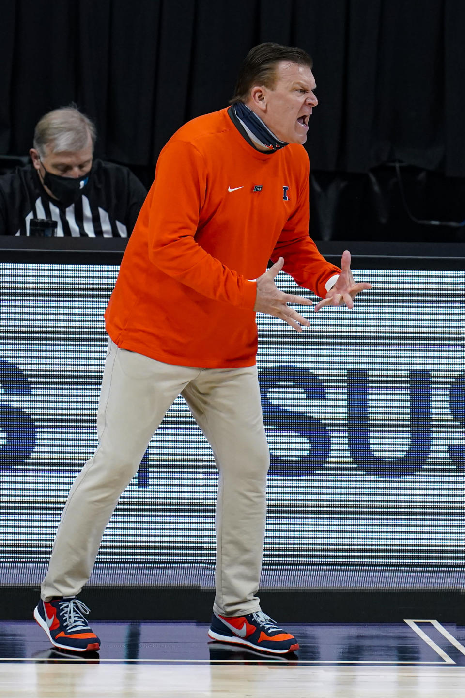 Illinois head coach Brad Underwood questions a call during the second half of an NCAA college basketball championship game against Ohio State at the Big Ten Conference tournament, Sunday, March 14, 2021, in Indianapolis. (AP Photo/Michael Conroy)