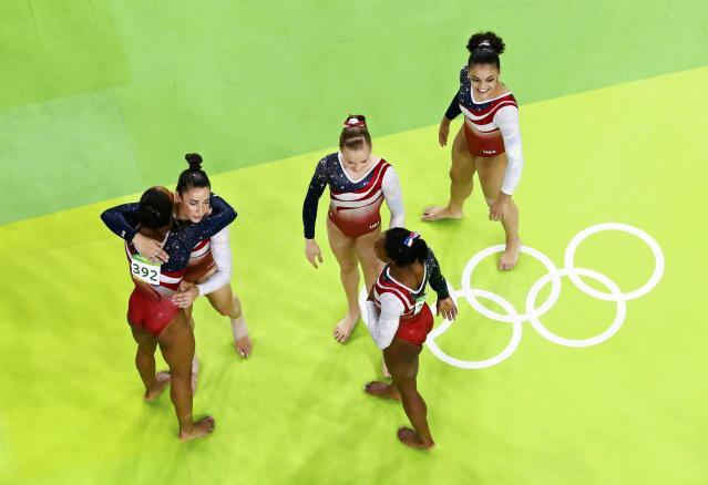 2016 Rio Olympics - Artistic Gymnastics - Final - Women's Team Final - Rio Olympic Arena - Rio de Janeiro, Brazil - 09/08/2016. Simone Biles (USA) of USA, Gabrielle Douglas (USA) of USA (Gabby Douglas), Laurie Hernandez (USA) of USA (393), Alexandra Raisman (USA) of USA (Aly Raisman), Madison Kocian (USA) of USA (C) celebrate winning the gold in the women's team final. REUTERS/Fabrizio Bensch FOR EDITORIAL USE ONLY. NOT FOR SALE FOR MARKETING OR ADVERTISING CAMPAIGNS.