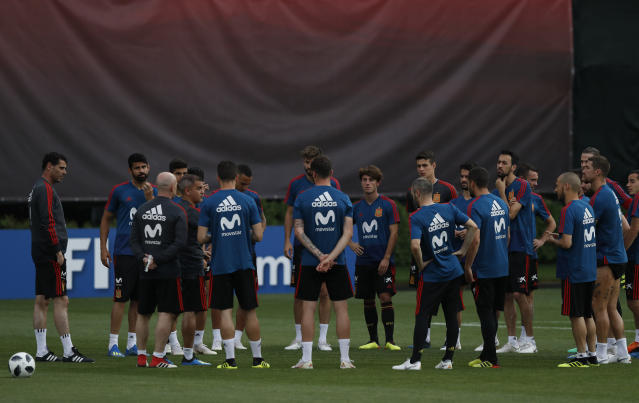 Spain's head coach Fernando Hierro, left, stands next to his players during a training session of Spain at the 2018 soccer World Cup in Krasnodar, Russia, Friday, June 22, 2018. (AP Photo/Manu Fernandez)