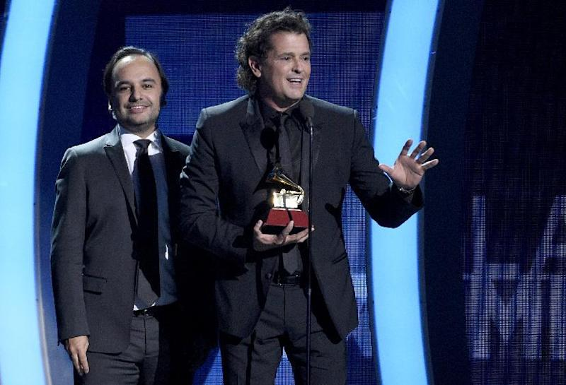 "Andres Castro, left, and Carlos Vives accept the award for record of the year for ""La Bicicleta"" at the 17th annual Latin Grammy Awards at the T-Mobile Arena on Thursday, Nov. 17, 2016, in Las Vegas. (Photo by Chris Pizzello/Invision/AP)"