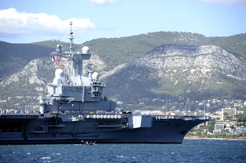 French aircraft carrier Charles de Gaulle pictured prior to a military parade in a bay near Toulon, southern France on August 15, 2014