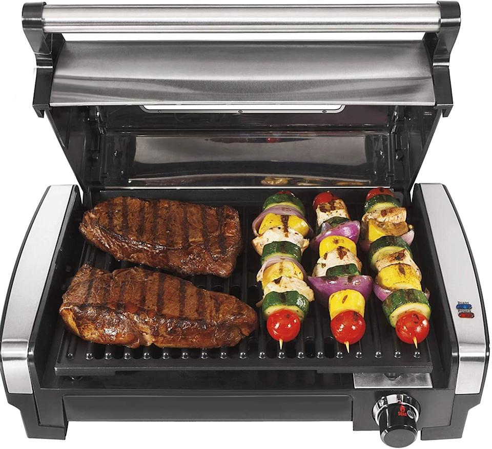 """Enjoy mouthwatering, perfectlycharred burgers, veggies and meats without having to fire up the grill outside.<br /><br /><strong>Promising review:</strong>""""Seriously, I love this grill. Recently moved into the city and can't use my grill so thought I'd give this a try.<strong>Man, it's amazing how well this works considering what it is and what it costs.</strong>I really can't see why anyone would have ANYTHING negative to say about it. The first two meals I cooked on it looked fantastic and tasted even better. Seriously, if you've been on the fence about this grill, get off and just buy it. You won't be disappointed."""" —<a href=""""https://amzn.to/3uU5Dmc"""" target=""""_blank"""" rel=""""nofollow noopener noreferrer"""" data-skimlinks-tracking=""""5723569"""" data-vars-affiliate=""""Amazon"""" data-vars-href=""""https://www.amazon.com/gp/customer-reviews/R2OMA4XJIP7376?tag=bfjasmin-20&ascsubtag=5723569%2C22%2C31%2Cmobile_web%2C0%2C0%2C14870765"""" data-vars-keywords=""""cleaning,fast fashion"""" data-vars-link-id=""""14870765"""" data-vars-price="""""""" data-vars-product-id=""""15988979"""" data-vars-retailers=""""Amazon"""">AdventureChuck</a><br /><br /><strong>Get it from Amazon for <a href=""""https://amzn.to/3af3DgE"""" target=""""_blank"""" rel=""""noopener noreferrer"""">$69.99</a> (available in five styles).</strong>"""