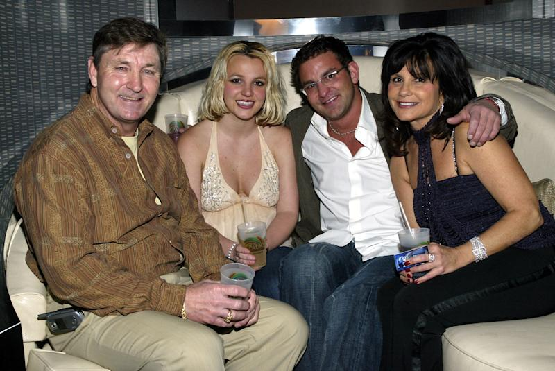 Singer Britney Spears (2nd,L) and family (L-R), father Jamie, brother Bryan and mother Lynne celebrate with Jamie Spears's partners (not shown) George and Phil Maloof and John Decastro, at the launch party for their new Palms Home Poker Host software held at the one of a kind Hardwood Suite at the Palms Casino Resort in Las Vegas. (Photo by Chris Farina/Corbis via Getty Images)