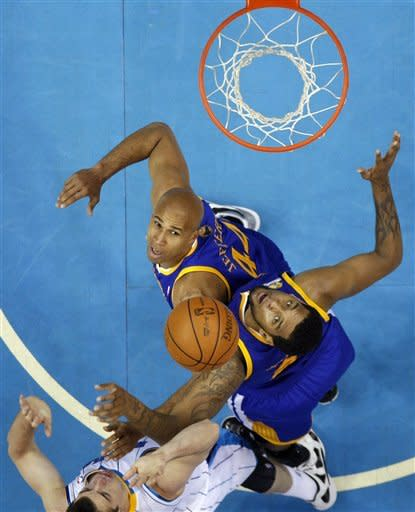 Golden State Warriors forward Richard Jefferson, top, and forward Jeremy Tyler, middle, battle for a rebound against New Orleans Hornets forward Jason Smith, bottom, in the first half of an NBA basketball game in New Orleans, Wednesday, March 21, 2012. (AP Photo/Gerald Herbert)
