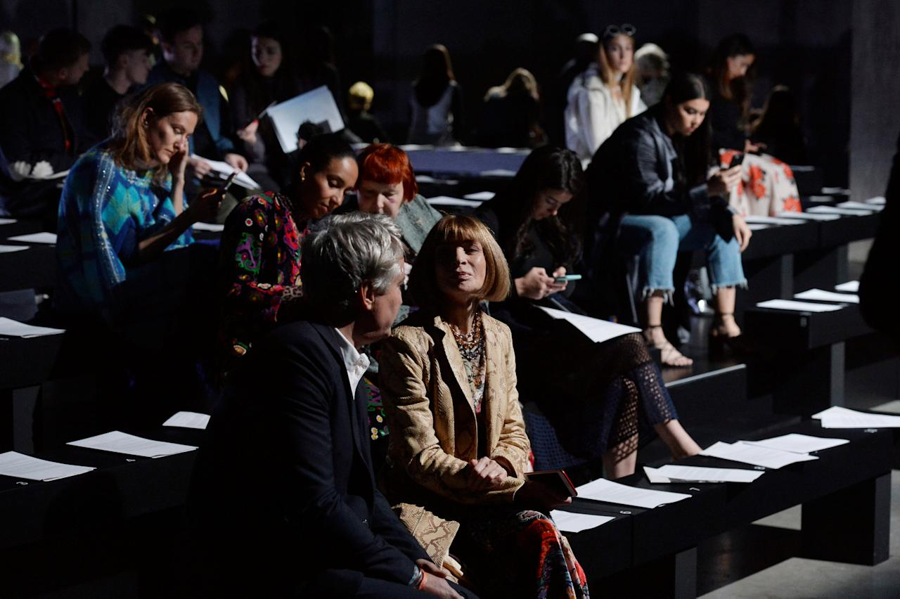 Anna Wintour and Francois Pinault sit in the first row during the front Christopher Kane Spring/Summer 2018 show at London Fashion Week, Britain September 18, 2017. REUTERS/Mary Turner