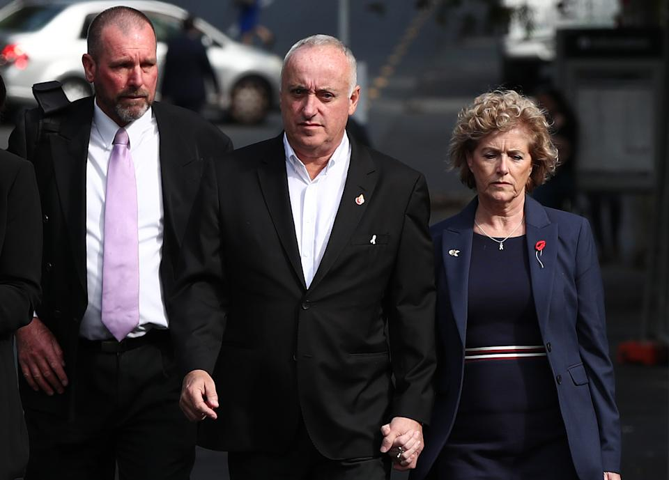 AUCKLAND, NEW ZEALAND - NOVEMBER 06:  Grace Millane's parents David (C) and Gillian (R) arrive with Detective Inspector Scott Beard (L)  at Auckland High Court on November 06, 2019 in Auckland, New Zealand. A 27 year old man is charged with the murder of British backpacker Grace Millane, whose body was found  in bush in West Auckland's Waitakere Ranges on 9 December 2018. There is currently a suppression order in place, prohibiting the publication of the accused's name. (Photo by Fiona Goodall/Getty Images)