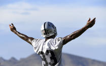 Las Vegas Raiders tight end Darren Waller reacts to teammates during an NFL football practice Saturday, July 31, 2021, in Henderson, Nev. (AP Photo/David Becker)