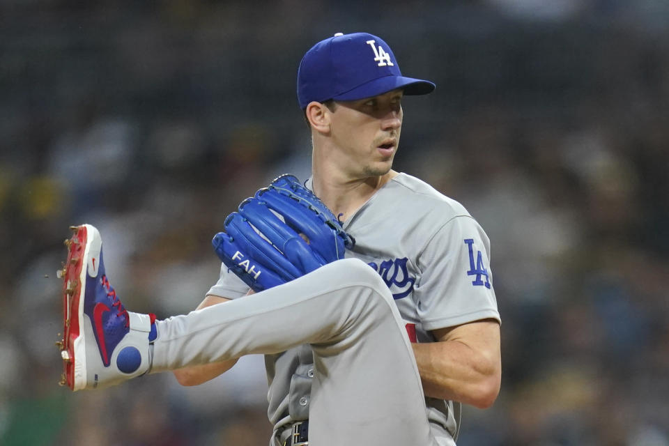 Los Angeles Dodgers starting pitcher Walker Buehler winds up during the first inning of the team's baseball game against the San Diego Padres on Wednesday, Aug. 25, 2021, in San Diego. (AP Photo/Gregory Bull)