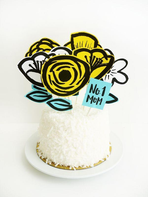 """<p>If you don't have time to make Mom a cake from scratch, buy a cake and decorate it with these awesome garden-themed cake toppers!</p><p><strong><span>Get the tutorial at </span><a href=""""http://ohhappyday.com/2015/05/printable-mothers-day-garden-cake-topper/"""" rel=""""nofollow noopener"""" target=""""_blank"""" data-ylk=""""slk:Oh Happy Day"""" class=""""link rapid-noclick-resp"""">Oh Happy Day</a></strong><span><strong>.</strong></span></p>"""