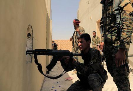 Members of the Syrian Democratic Forces try to locate Islamic State's sniper in Al Senaa, a district of  Raqqa, Syria August 10, 2017. REUTERS/Zohra Bensemra