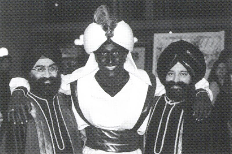 """This April 2001 photo, which appeared in a newsletter from the West Point Grey Academy, shows a costumed Justin Trudeau, his face and hands darkened by makeup, attending an """"Arabian Nights"""" gala. The academy is a private school in Vancouver, B.C., where Trudeau worked as a teacher before entering politics. (West Point Grey Academy/The Canadian Press via AP)"""