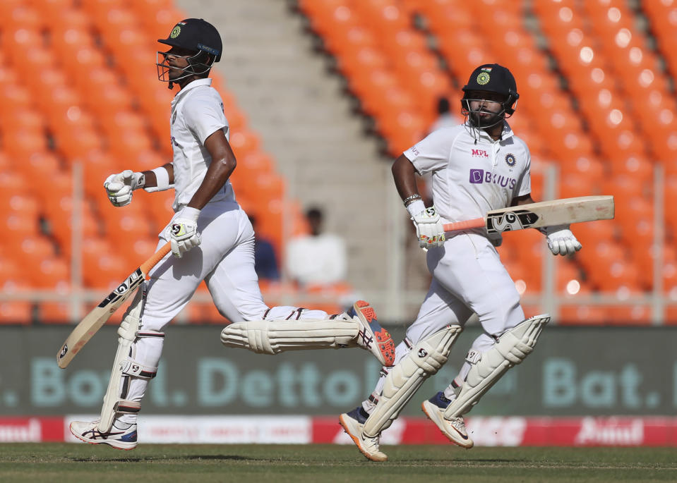India's Rishabh Pant, right, and Washington Sundar run between the wickets to score during the second day of fourth cricket test match between India and England at Narendra Modi Stadium in Ahmedabad, India, Friday, March 5, 2021. (AP Photo/Aijaz Rahi)