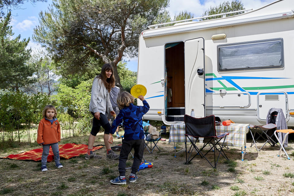 GARGANTILLA DE LOZOYA, SPAIN - JUNE 13: A family enjoys a weekend with their motorhome at the Monte Holiday campsite on June 13, 2020 in Gargantilla de Lozoya y Pinilla de Buitrago, Spain. The campsite, which had to close during the country's months-long coronavirus lockdown, has a capacity for 1,200 people and is completely booked for every weekend from mid-July through August. They have an average of 4,000 daily visits on the web and are seeing a large increase in people who come with motorhomes. (Photo by Carlos Alvarez/Getty Images)