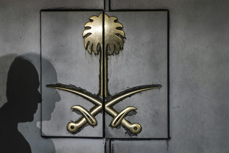 The shadow of a security guard is seen on the entrance door of the Saudi Arabia's consulate in Istanbul, on October 12, 2018