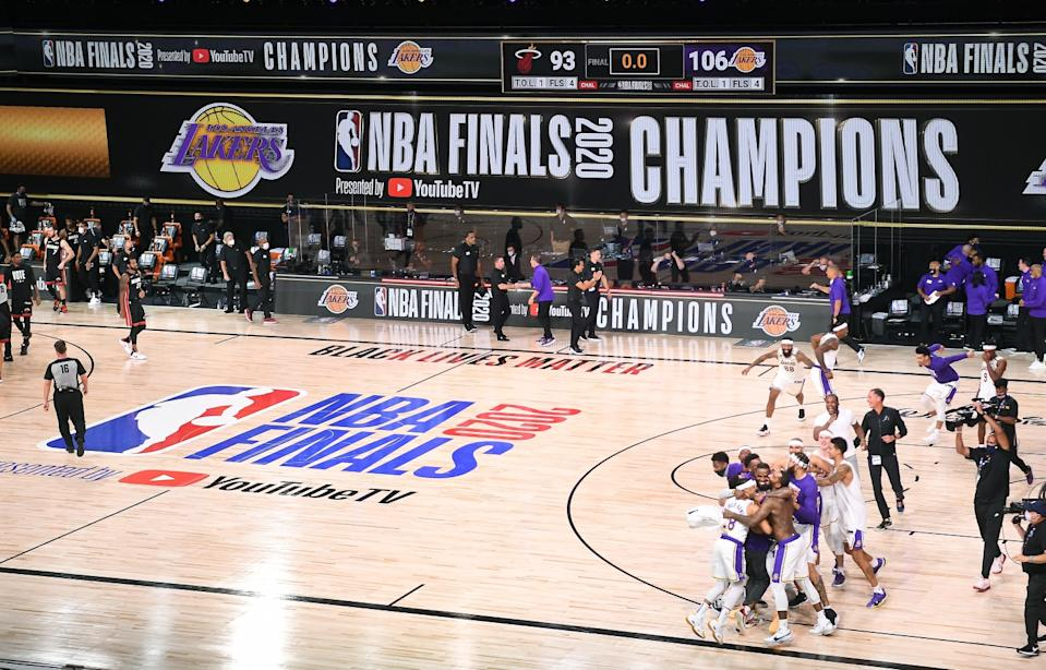 The Lakers celebrate after defeating the Miami Heat to win the NBA championship on Oct. 11.