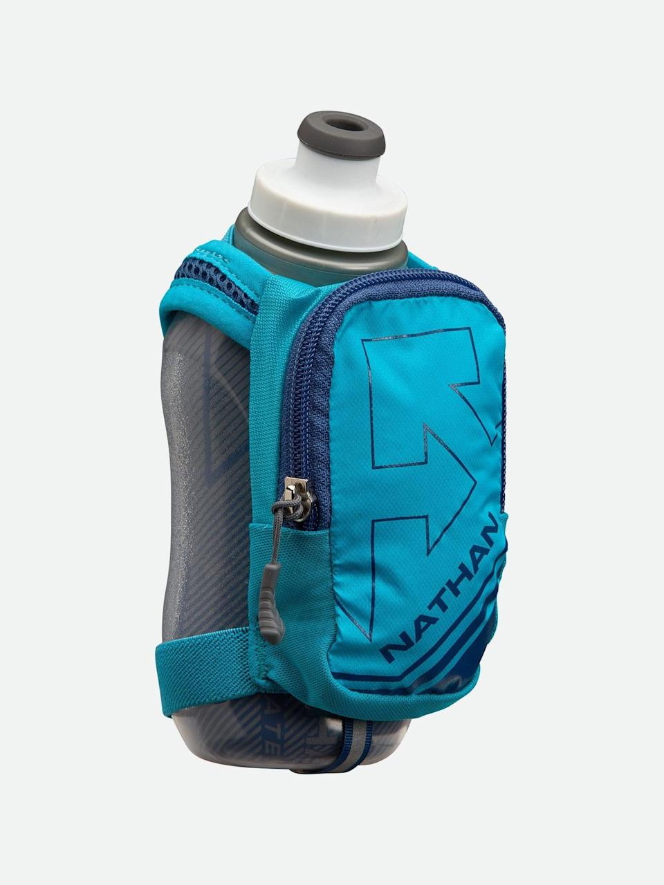 """<h3>Nathan Sports SpeedShot Plus Insulated Flask</h3><br>""""Honestly, I used to get my mid-run water from the public water fountains in my local park. The pandemic made that seem like a bad idea. Luckily, I had this <a href=""""https://www.refinery29.com/en-us/best-reusable-water-bottle"""" rel=""""nofollow noopener"""" target=""""_blank"""" data-ylk=""""slk:water bottle"""" class=""""link rapid-noclick-resp"""">water bottle</a>. The strap grips my hand so I don't have to hold onto it — I can forget it's there until I need a sip. I like that the pouch can hold a key and ID, too."""" <em>— MZ</em><br><br><strong>Nathan Sports</strong> Nathan Sports SpeedShot Plus Insulated Flask, $, available at <a href=""""https://go.skimresources.com/?id=30283X879131&url=https%3A%2F%2Fwww.nathansports.com%2Fproducts%2Fspeedshot-plus-insulated-flask-bluebird-true-navy"""" rel=""""nofollow noopener"""" target=""""_blank"""" data-ylk=""""slk:Nathan Sports"""" class=""""link rapid-noclick-resp"""">Nathan Sports</a>"""