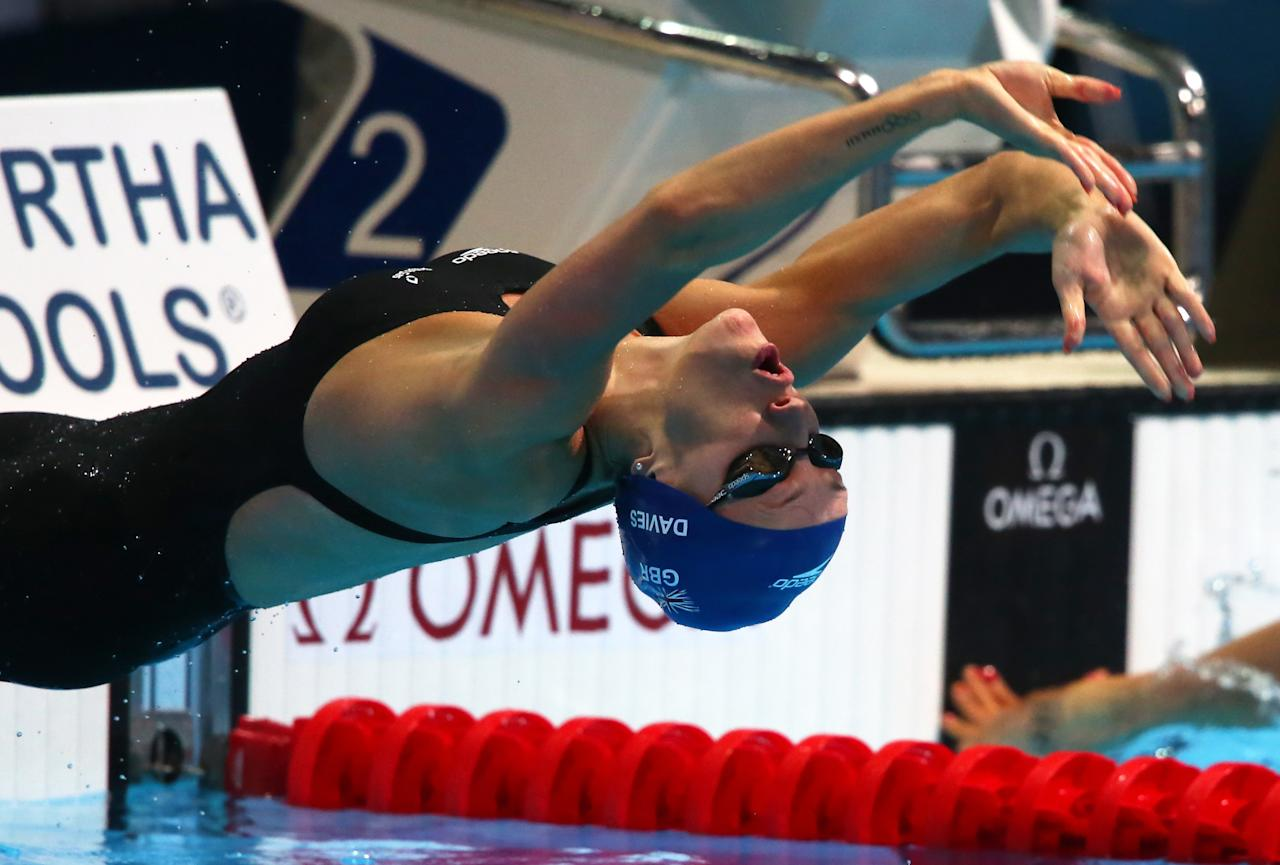 BARCELONA, SPAIN - JULY 31: Georgia Davies of Great Britain competes during the Swimming Women's 50m Backstroke preliminaries heat six on day twelve of the 15th FINA World Championships at Palau Sant Jordi on July 31, 2013 in Barcelona, Spain. (Photo by Alexander Hassenstein/Getty Images)