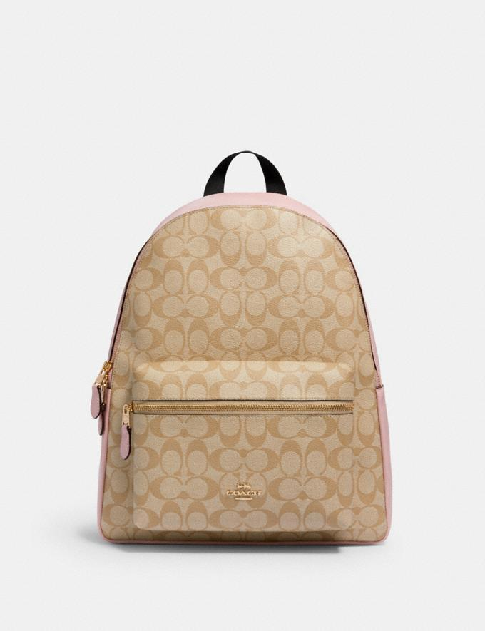 Charlie Backpack In Signature Canvas. Image via Coach Outlet.
