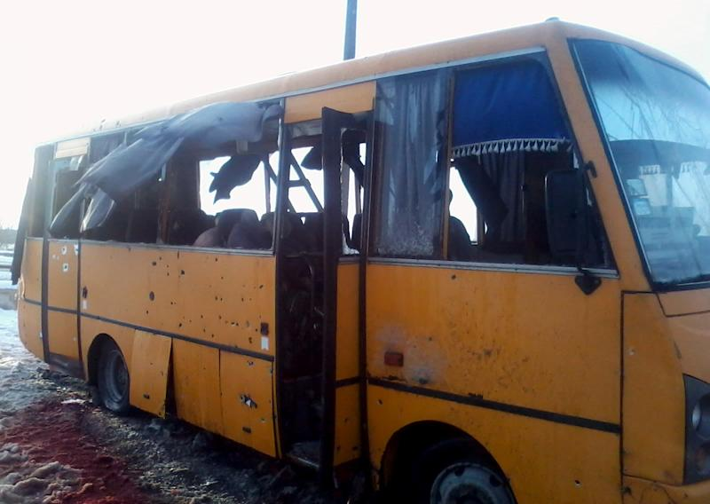 This handout picture taken on January 13, 2015 by Anti-Terrorist Operation press service shows a damaged bus after it was hit by a long-range Grad rocket apparently fired by pro-Russian insurgents in Volnovakha (AFP Photo/)